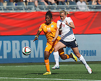 Moncton, New Brunswick - June 15, 2015: First half action. In a FIFA Women's World Cup Canada 2015 Group B match, Norway (white/blue) vs Cote d'Ivorie (orange), 1-0 (halftime), at Moncton Stadium.