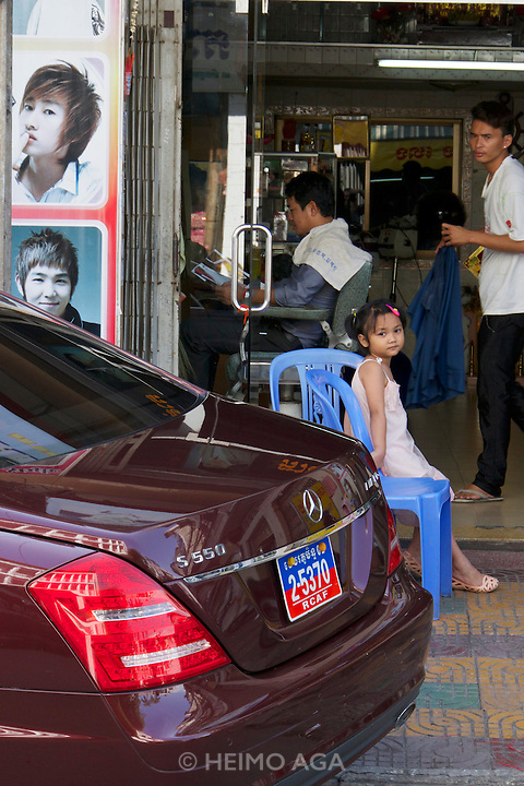 Phnom Penh, Cambodia. Little girl at a hairdresser.
