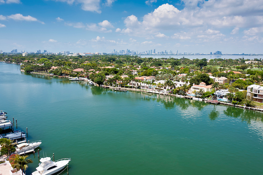 Aerial view of the Indian Creek Canal in Miami Beach with Downtowm Miami skyline in the back.
