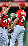 2 September 2012: Washington Nationals' team photographer Mitchell Layton captures the winning celebrations after a game against the St. Louis Cardinals at Nationals Park in Washington, DC. The Nationals edged out the visiting Cardinals 4-3, capping their 4-game series with three wins. Mandatory Credit: Ed Wolfstein Photo