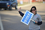Allyson Mize holds a sign for sheriff candidate Gary Morris outside the Oxford Conference Center in Oxford, Miss. on Tuesday, November 8, 2011. Mississippians go to the polls today for state and local elections, as well as referendums including the so-called Personhood Amendment.