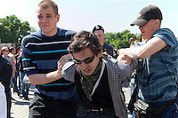 Moscow, Russia, 28/05/2011..Plain-clothes police seize a gay rights activist at an attempted gay pride parade in central Moscow. Several dozen people were arrested during clashes as Russian nationalists attacked gay rights activists during their sixth attempt to hold a gay pride parade in the Russian capital.