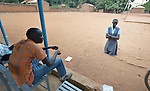 Forced to kneel in the dust, a student is disciplined by a teacher at the John Paul II School in Wau, South Sudan.