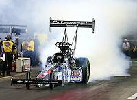 Jun 19, 2015; Bristol, TN, USA; NHRA top fuel driver Larry Dixon during qualifying for the Thunder Valley Nationals at Bristol Dragway. Mandatory Credit: Mark J. Rebilas-