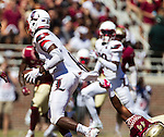 Florida State defensive end DeMarcus Walker (44) drags down Louisville quarterback Lamar Jackson in the first half of an NCAA college football game in Tallahassee, Fla., Saturday, Oct. 17, 2015. (AP Photo/Mark Wallheiser)