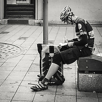 Messenger resting and taking notes on a bench in central Budapest Hungary
