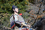 "Dressed in ornate period costume, a member of the Toyama-ryu ""yabusame"" horseback archery group rides his horse along the course during an event in Machida, western Tokyo, Japan on Nov. 28 2010. During the late Heian era (794 to 1185) and Kamakura era (1185-1333) such archery was the domain of high-ranked samurai and was used as a military training exercise to keep samurai prepared for war. .Photographer: Robert Gilhooly"