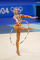 Dominika Cervenkova of Czech Republic apparatus handling with hoop during qualifications round at Athens Olympic Games on August 26, 2004 at Athens, Greece. (Photo by Tom Theobald)