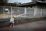 Fukushima city, April 27 2011 - .(eng) Located 60km from the plant, Fukushima city was not evacuated. In this playground, radioactivity can reach 5microSv/h, the same level as some areas inside the 20km radius. The playground was closed several weeks after the accident. The school is open...(fr) Situee a pres de 60km de la centrale, la ville de Fukushima n'a pas ete evacuee. Dans ce terrain de jeu d'une ecole, le niveau de radioactivite peut atteindre par endroit et ponctuellement 5microSv/h, autant qu'a l'interieur des 20km. Le terrain a ete ferme plusieurs semaines apres le debut des incidents a la centrale. L'ecole est restee ouverte.