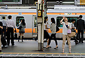 Tokyo, Japan - A Japanese woman puts apply eye drops as she waits for the train to arrive. Morning commuters typically spend over one hour on the train going to work. Trains are usually so packed that train platform staff have to push commuters to fit in the train so that the doors can close shut. (Photo by Yumeto Yamazaki/AFLO)