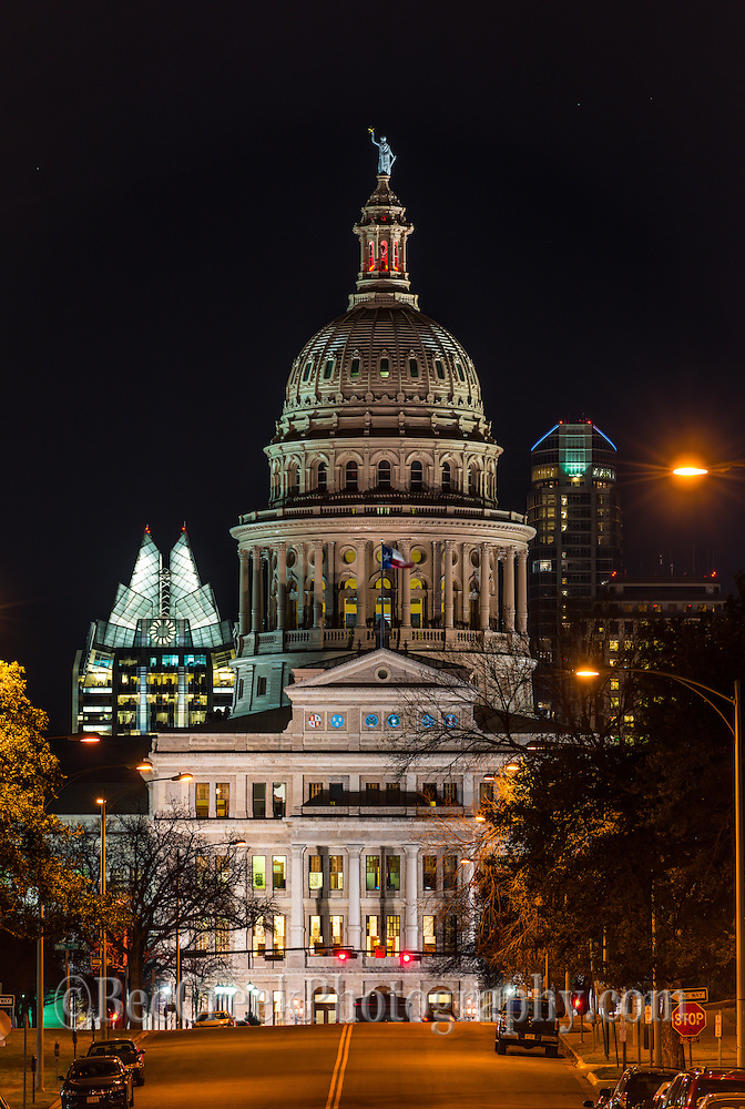 This a vertical view of Capital of Texas at night view from MLK street.  You can see the Frost building and the Austonian in the background.