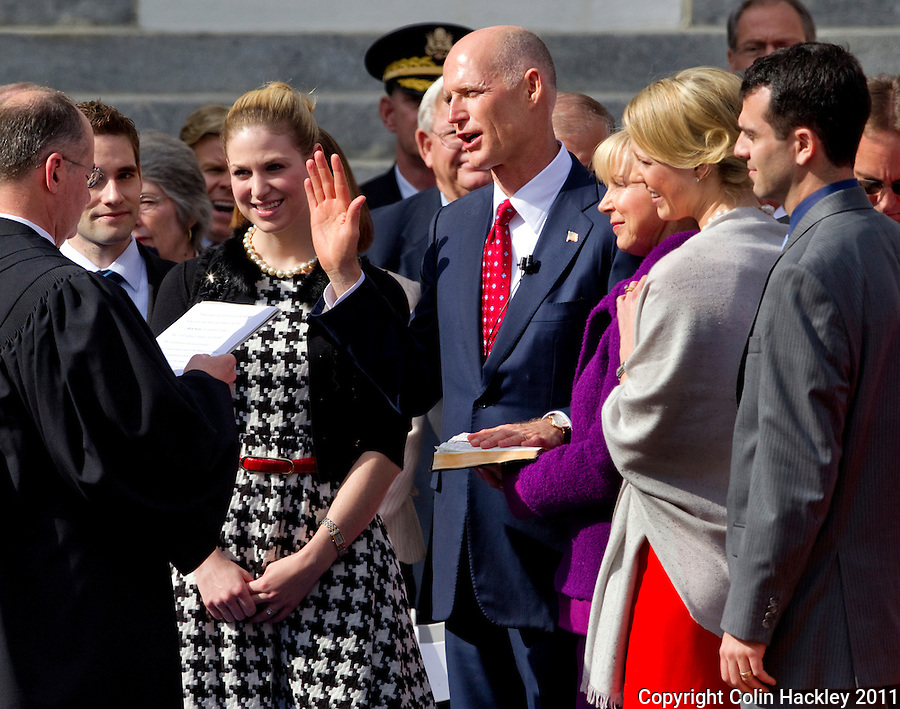 TALLAHASSEE, FLA. 1/4/11-SCOTTINAUG010411 CH-Gov. Rick Scott takes the oath of office during inaugural ceremonies Tuesday at the Capitol in Tallahassee..COLIN HACKLEY PHOTO