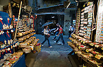 Shoppers pass a souvenir shop in the Spaccanapoli shopping district of Naples.