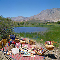 A number of substantial picnic hampers auger well for this lunch al-fresco with the compelling landscape of the Little Karoo as a backdrop
