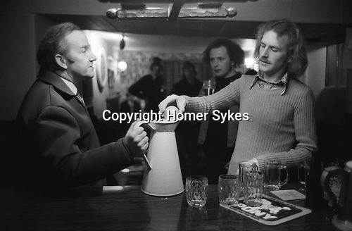 Hurling the Silver Ball. St Columb, Cornwall, England 1974. <br /> <br /> Played annually on Shrove Tuesday. At St Columb hurling is played by two teams comprising of of Townsmen and Countrymen.<br /> <br /> After the game, that evening, the silver ball is placed in a jug of ale by David Juszczak. Silver beer is provided in all the pubs in the village and is on the house.