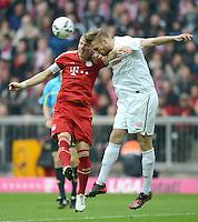 FUSSBALL   1. BUNDESLIGA  SAISON 2011/2012   31. Spieltag FC Bayern Muenchen - FSV Mainz 05       14.04.2012 Bastian Schweinsteiger (li, FC Bayern Muenchen) gegen Jan Kirchhoff (1. FSV Mainz 05)