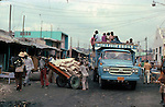 Truck, cart and people. Images of the capital,Port au Prince, Haiti 1975