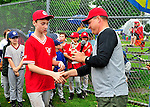 11 June 2011: The Burlington American Little League coaches award the 12-year-old players a commemorative trophy celebrating their Little League careers at Calahan Park in Burlington, Vermont. Mandatory Credit: Ed Wolfstein Photo