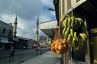 Stall selling fruit on the sidewalk outside the Al Husseini mosque in Amman, Jordan.