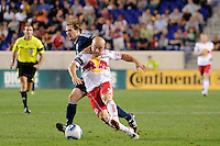 Luke Rodgers (9) of the New York Red Bulls is defended by Jonathan Leathers (25) of the Vancouver Whitecaps. The New York Red Bulls  and the Vancouver Whitecaps played to a 1-1 tie during a Major League Soccer (MLS) match at Red Bull Arena in Harrison, NJ, on September 10, 2011.