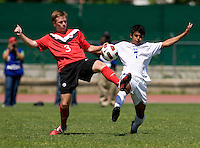 Kelvin Nunez (7) of Honduras fights for the ball with Adam Polakiewicz (3) of Canada during the group stage of the CONCACAF Men's Under 17 Championship at Catherine Hall Stadium in Montego Bay, Jamaica. Canada tied Honduras, 0-0.