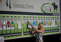 Post Position assistant Catherine Jones places Went The Day Well in the 13-Post during the Post Position Draw for the 138th Kentucky Derby at Churchill Downs in Louisville, Kentucky on May 2, 2012.