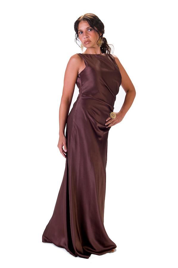 Latin woman posing with night elegant dress.