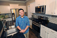 NWA Democrat-Gazette/ANDY SHUPE<br /> Jovi Champaphanith's stands Saturday, April 16, 2016, in his favorite space, his kitchen in his home in Centerton.