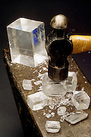 BREAKING CALCITE WITH A HAMMER<br /> Iceland Spar is Clear, Cleaved Calcite<br /> Also known as Optical Calcite, it displays Calcite's classic cleavage form - the rhombohedron, and is the most stable polymorph of calcium carbonate. (CaCO3)