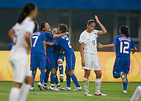Japanese captain (10) Homare Sawa celebrates her goal with teammates during first round play in the 2008 Beijing Olympics at Qinhuangdao, China. .  Japan tied New Zealand, 2-2, at Qinhuangdao Stadium.