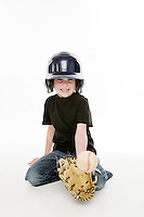 Tucker Ward 5 year old boy playing catch with baseball mitt, helmet and ball in the studio.