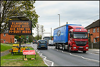 BNPS.co.uk (01202 558833)<br /> Pic: GrahamHunt/BNPS<br /> <br /> Diversion in Shaftesbury that sends HGV's down the C13 through Melbury Abbas.<br /> <br /> A sleepy Dorset village is getting jammed up to 18 times a week with big lorries after highways officials deliberately directed them to drive through it in a controversial traffic experiment.<br /> <br /> The 'unbelievable' strategy has brought havoc and misery to Melbury Abbas where villagers are getting used to the sight of a 30 tonne HGV blocking the narrow main road.<br /> <br /> Cars heading through the pretty hamlet face delays of up to an hour whenever a hapless trucker attempts to pass another large vehicle using the C13.<br /> <br /> Kerbs, grass verges and a water hydrant have been badly damaged by truckers mounting them to create space to squeeze though, while one HGV came within just 2ins of colliding with a Grade II listed property on one occasion.