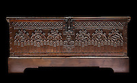 Oak trunk used to store clothing, late 15th century, with symmetrical carving of lancets with quatrelobes and a stylised fleur de lys, in Les Hospices de Beaune, or Hotel-Dieu de Beaune, a charitable almshouse and hospital for the poor, built 1443-57 by Flemish architect Jacques Wiscrer, and founded by Nicolas Rolin, chancellor of Burgundy, and his wife Guigone de Salins, in Beaune, Cote d'Or, Burgundy, France. The hospital was run by the nuns of the order of Les Soeurs Hospitalieres de Beaune, and remained a hospital until the 1970s. The building now houses the Musee de l'Histoire de la Medecine, or Museum of the History of Medicine, and is listed as a historic monument. Picture by Manuel Cohen