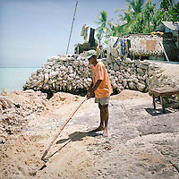 Naniten has collected coral rocks from the reef in the lagoon for three years and he is now building an enclosure that he will fill with organic and inorganic waste, compact it then pile coral sand and soil on top. This reclaims land that has in the past eroded into the lagoon.