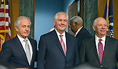United States Senator Bob Corker (Republican of Tennessee), left, Chairman, US Senate Committee on Foreign Relations, left, Rex Wayne Tillerson, former chairman and chief executive officer of ExxonMobil, center, and US Senator Ben Cardin (Democrat of Maryland), ranking member, right, arrive for the hearing on Tillerson's nomination to be Secretary of State of the US on Capitol Hill in Washington, DC on Wednesday, January 11, 2017.<br /> Credit: Ron Sachs / CNP