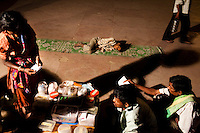 Laxmi (extreme left), a 'solution' addict and mother of Sunny (center), aged 10, receives medication from the mobile clinic pharmacist at Jama Masjid while Sunny sleeps nearby as he is too high on drugs on 4th October 2010, in New Delhi, India. Picture: Suzanne Lee for The Australian.