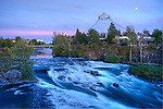 Washington, Spokane, Riverfront Park. Moon rise over the Pavillion remaining from EXPO 74 world's fair, and rapids on the Spokane River above the falls.