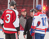 Josh Manson (NU - 3), Jeff Bunyon, Josh Holmstrom (UML - 12) - The Northeastern University Huskies defeated the University of Massachusetts Lowell River Hawks 4-1 (EN) on Saturday, January 11, 2014, at Fenway Park in Boston, Massachusetts.