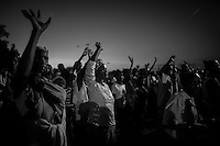 Kakuma, Kenya: Refugees and members of the host community came together to pray at an outdoor mass in Kakuma town at dusk.