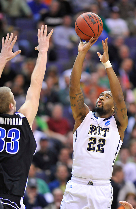Brad Wannaker of Pitt shots over D.J. Cunningham of UNC-Asheville. Pittsburgh defeated UNC-Asheville 74-51 during the NCAA tournament at the Verizon Center in Washington, D.C. on Thursday, March 17, 2011. Alan P. Santos/DC Sports Box