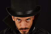 People stock photo of an evil villain with top hat and cape with character expressions