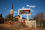South African church with save the rhino anti-poaching slogan on electronic advertising billboard, Klerksdorp, North west province, South Africa, June 2012