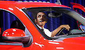 United States President Barack Obama looks at Chevrelot Silverado during a visit to the DC Auto Show at the Walter E. Washington Convention Center in Washington, DC on January 31, 2012. .Credit: Olivier Douliery / Pool via CNP