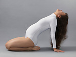 Pregnant young woman in a white bodysuit