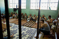 Pro-regime prisoners are seen in a school being used by the Free Syrian Army (FSA) as a prison in Mari.