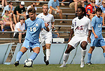 06 September 2009: UNC's Kirk Urso (18) and Evansville's Reggie Edu (8). The University of North Carolina Tar Heels defeated the Evansville University Purple Aces 4-0 at Fetzer Field in Chapel Hill, North Carolina in an NCAA Division I Men's college soccer game.