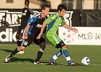 Nathan Sturgis of Sounders kicks the ball away from Sam Cronin of Earthquakes during the game at Buck Shaw Stadium in Santa Clara, California on July 31st, 2010.   Seattle Sounders defeated San Jose Earthquakes, 1-0.