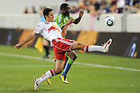 Mike Petke (12) of the New York Red Bulls plays the ball away from Steve Zakuani (11) of the Seattle Sounders. The Seattle Sounders defeated the New York Red Bulls 1-0 during a Major League Soccer (MLS) match at Red Bull Arena in Harrison, NJ, on May 15, 2010.
