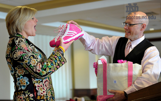 Feb. 12, 2011; College of Science dean Greg Crawford presents NBC News correspondent Anne Thompson with a special pink pair of shoes  worn by the Women's Basketball team for the 2011 Pink Zone game.  Thompson, a Notre Dame alumna and breast cancer survivor, spoke at the Pink Zone luncheon in Club Naimoli before the game...Photo by Matt Cashore/University of Notre Dame