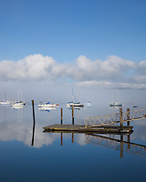 Vashon-Maury Island<br /> Clearing morning fog with moored sailboats and dock reflections at Dockton - Quartermaster Harbor